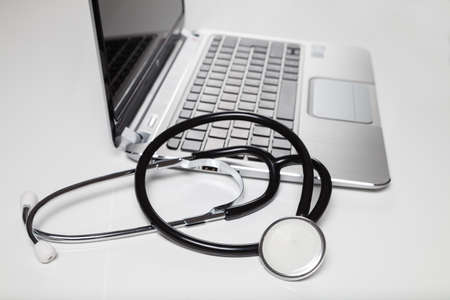 pratice: stethoscope and laptop on desk Stock Photo