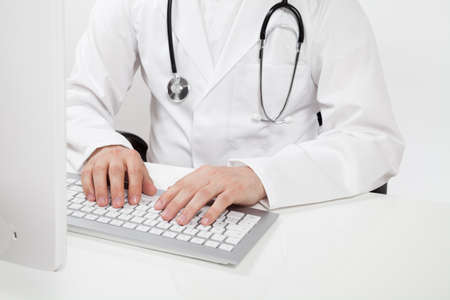pratice: doctor typing on computer in doctors office
