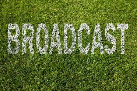 broadcast written on a green meadow photo