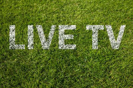 live tv text on a green meadow photo