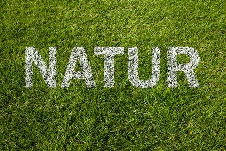 natur: natur written on green grass Stock Photo