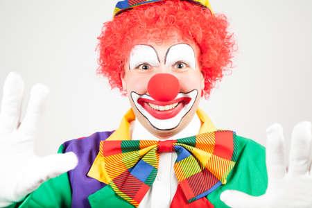 ballyhoo: smiling clown with white gloves