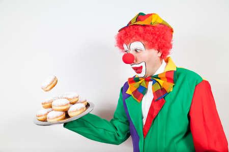 ballyhoo: clown with falling pancake tray on white background