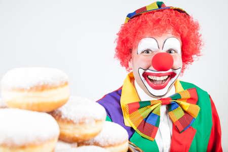 ballyhoo: clown with pancakes on white
