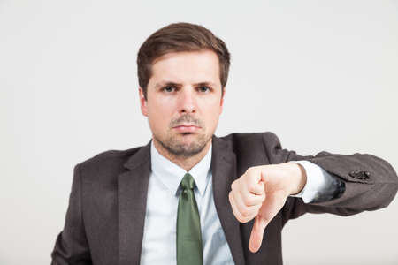 hands with thump down of a businessman Stock Photo