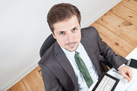 businessman in office and tablet on desk photo
