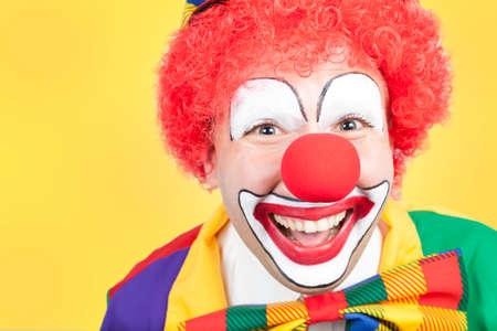 ballyhoo: clown close on yellow background