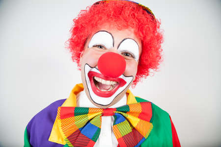 ballyhoo: smiling clown with red hair on white Stock Photo