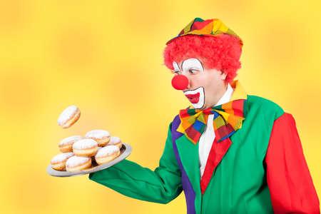 ballyhoo: clown with pancake on tray on yellow background