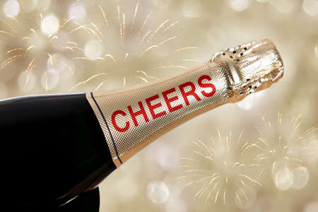 Cheers written on champagne bottle on new year