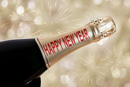Happy New Year written on champagne bottle Stock Photo