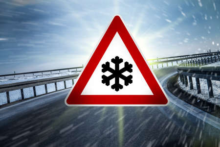 icy conditions: winter road sign on highway Stock Photo