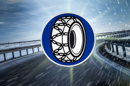 snow tire sign on highway photo