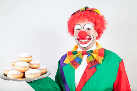 ballyhoo: clown withe biscuits on tray on white