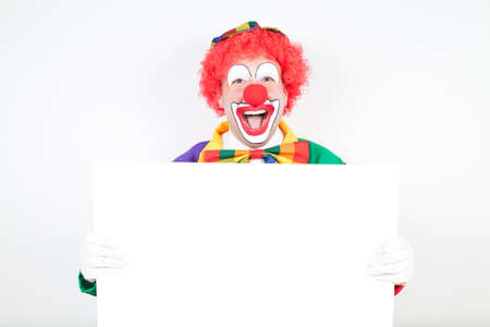 ballyhoo: clown with blank board on white background Stock Photo