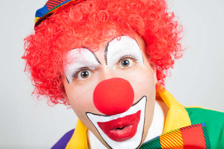 amazed clown on white background photo