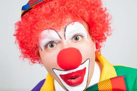 ballyhoo: amazed clown on white background