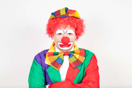 miffed: huffy clown on white background Stock Photo