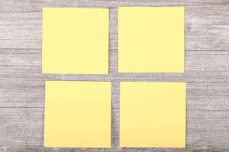 yellow stickies on grey background photo