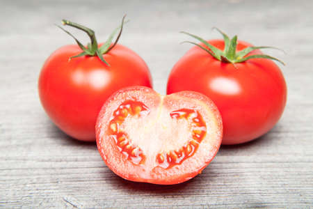 glutamate: Two and a sliced ??tomato on gray table