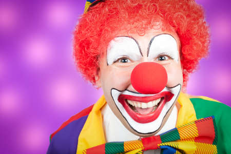 clown closeup with violet background Stock Photo
