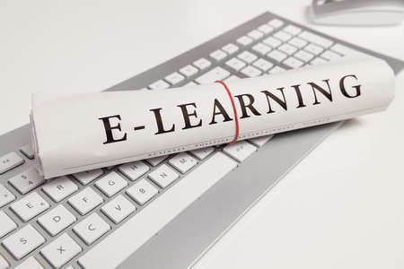 written: e-learning written on newspaper
