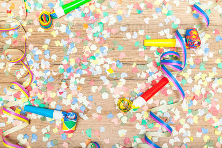 childrens birthday party: carnival background with confetti and paper streamer