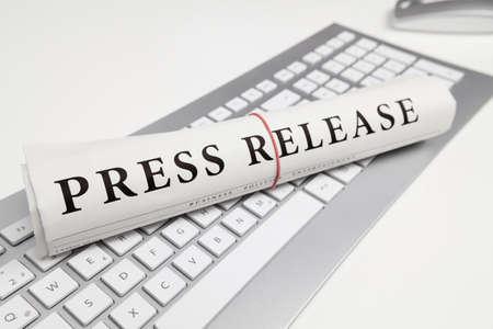 press release written on newspaper Stockfoto