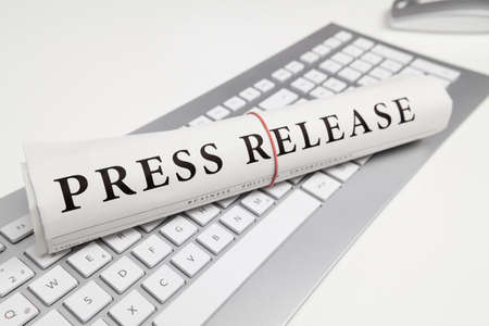 press release written on newspaper Stock Photo