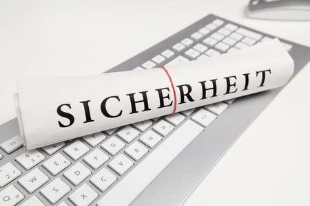 security in german on newspaper photo
