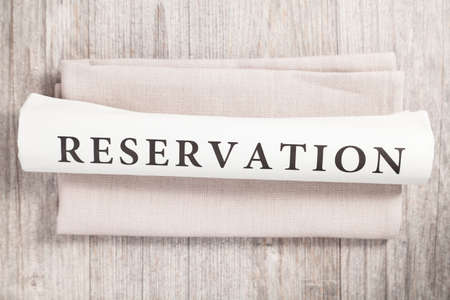 reservation: reservation written on a newspaper Stock Photo