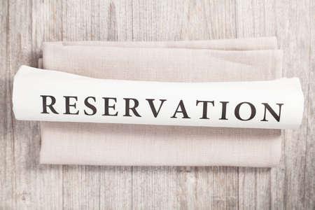 reservation written on a newspaper Standard-Bild