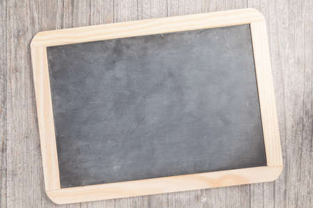 inscribe: small blackboard on wooden plate Stock Photo