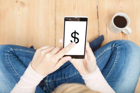 pays: woman pays via smartphone