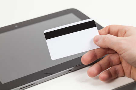 misuse: bank card in hand and tablet