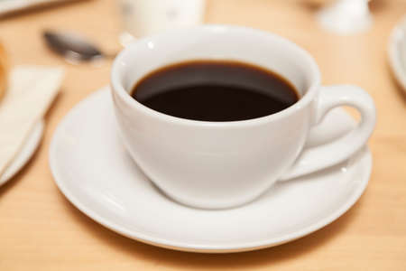 bap: cup of coffee on a table Stock Photo