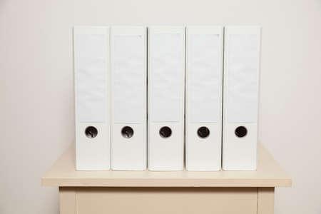 Five white Folders