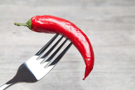 peperoni: peperoni impaled with a fork