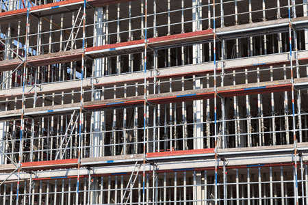 building sector: scaffold on house building background Stock Photo