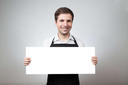 pinafore: man with apron and board on grey background