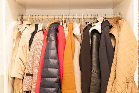 garderobe: femal wardrobe with winter and summer jackets