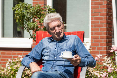 oldage: Man with cup of coffee