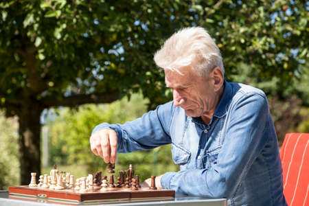 oldage: Pensioners playing chess Stock Photo