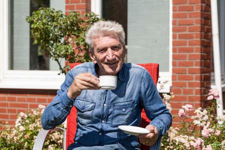 oldage: Man drinks his coffee