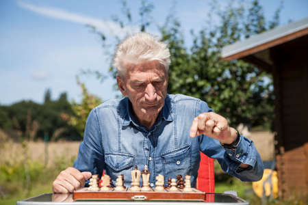 chessboard: Pensioner with chessboard Stock Photo