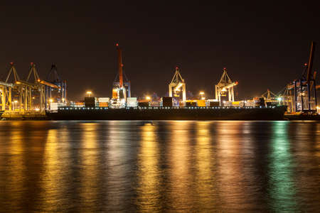 containership: Containership by night in Hamburg
