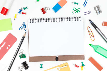 inscribe: Blank sheet with office accessories