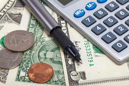 financial stability: Pocket calculator and dollar cash