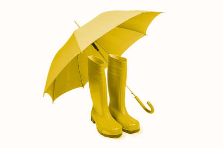 Rubber boots and umbreall isolated in yellow