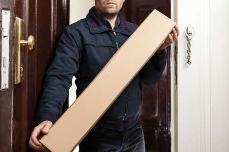 online service: Postman brings a parcel in special size